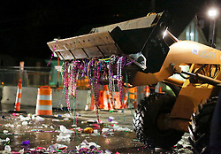 03 February 2016. New Orleans, Louisiana.<br /> Mardi Gras. Clean up crews go to work collecting tons of discarded plastic and debris following the all female Mystic Krewe of Nyx parade along Magazine Street.<br /> Photo©; Charlie Varley/varleypix.com