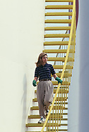A Mobil Oil employee  on a storage tank in Newington Virginia.<br />Photo by Dennis Brack. bb77
