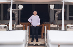 © Licensed to London News Pictures. 13/05/2018. London, UK. Alan Sugar seen standing on his luxury superyacht, Lady A as it is moored at Butlers Wharf on the River Thames today shortly before Alan Sugar sailed it under Tower Bridge and paraded it in the Upper Pool in central London, before passing under Tower Bridge again and travelling along the river. Alan Sugar reportedly purchased the 181 feet long yacht in 2015 and renamed her Lady A after his wife, Ann and it includes a jacuzzi and can sleep up to 12 guests. Lady A is reportedly still up for sale at around £13m after being put on the market last year, or it can be chartered with prices starting from around £12,500 per week. Photo credit: Vickie Flores/LNP