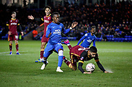 Peterborough United midfielder Siriki Dembele (10) fouls Bradford City defender Kelvin Mellor (15)  during  the The FA Cup 2nd round match between Peterborough United and Bradford City at London Road, Peterborough, England on 1 December 2018.