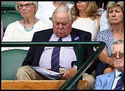 July 4, 2018 - London, London, United Kingdom - Wimbledon Tennis Championships-Day Three.  A spectator appears to have a sleep on centre court during the  Wimbledon Tennis Championships. (Credit Image: © Andrew Parsons/i-Images via ZUMA Press)