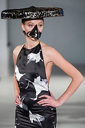 © Licensed to London News Pictures. 21/02/2015. Grand Connaught Rooms, Covent Garden, London, UK.   A model wears an elaborate hat and beak face mask as they present a look at the Vietinio AW15 collection at the Grand Connaught Rooms during London Fashion Week's Off Schedule Show. Photo credit : Stephen Chung/LNP