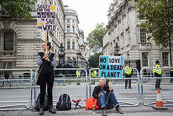 London, UK. 8 October, 2019. Climate activists from Extinction Rebellion in Whitehall on the second day of International Rebellion protests to demand a government declaration of a climate and ecological emergency, a commitment to halting biodiversity loss and net zero carbon emissions by 2025 and for the government to create and be led by the decisions of a Citizens' Assembly on climate and ecological justice.