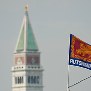 VENICE, ITALY - SEPTEMBER 18:  A separatist motto on a Venetian flag is seen in front of St Mark's belfry on the day of  Lega Nord annual political rally  on September 18, 2011 in Venice, Italy. The Northern League rally is held to call for the independence of Northern Italy, during which the leader of Lega Nord pours water from the River Po in the north of Italy into the Venetian Lagoon as a symbolic rite known as Rito dell'ampolla.