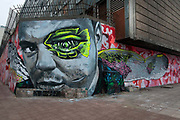 Egypt, Cairo 2014. Mohammed Maansour Street. Revolutionary grafitti of boy shot in the eye with angel's wings .
