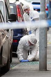 © Licensed to London News Pictures . 13/06/2018. Manchester , UK. Forensic scenes of crime examiners at the scene on Birch Street , Ashton-Under-Lyne where a man was critically hurt in a shooting , this afternoon . Photo credit : Joel Goodman/LNP