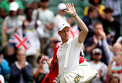 Kyle Edmund waves to the crowd after winning his match on day one of the Wimbledon Championships at the All England Lawn Tennis and Croquet Club, Wimbledon.