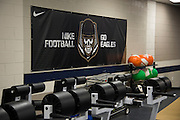 """A Nike banner hangs on the wall of the weight room at Allen High School in Allen, Texas on August 24, 2016. """"CREDIT: Cooper Neill for The Wall Street Journal""""<br /> TX HS Football sponsorships"""