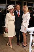 Countess of March and Kinrara and  Alexandra Gordon-Lennox. Glorius Goodwood. 27 July 2005. ONE TIME USE ONLY - DO NOT ARCHIVE  © Copyright Photograph by Dafydd Jones 66 Stockwell Park Rd. London SW9 0DA Tel 020 7733 0108 www.dafjones.com