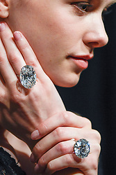 © Licensed to London News Pictures. 06/04/2018. LONDON, UK. A model presents a 50.39-carat oval diamond (top) and a 51.71-carat round brilliant-cut diamond (bottom) at a photocall at Sotheby's, New Bond Street. They are two of the largest, purest white diamonds ever to come to auction, have a combined estimate in excess of US$15m and will be sold at auction in Geneva on 15 May.  Photo credit: Stephen Chung/LNP