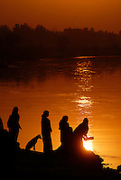 An Indian family performs a ritual on the banks of Yamuna River in Agra, India.