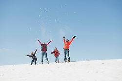Family playing with snow in winter, Bavaria, Germany