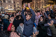 Members of the International Hare Krishna movement celebrate with the public during an unofficial New Years Eve street dance at Piccadilly on the 31st December 2019 in London in the United Kingdom.