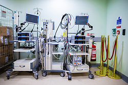 © Licensed to London News Pictures . 11/02/2021. Wythenshawe , UK . ECMO devices sit ready for deployment in a corridor , alongside barriers used for the historical royal opening of the hospital . ECMO - ExtraCorporeal Membrane Oxygenation - provides cardiac and respiratory support to patients whose heart and lungs are unable to provide sufficient gas exchange . Photo credit : Joel Goodman/LNP