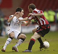 Photo: Aidan Ellis.<br /> Sheffield United v Swansea City. The FA Cup. 06/01/2007.<br /> Swansea's Leon Britton takes on Sheffield's Alan quinn