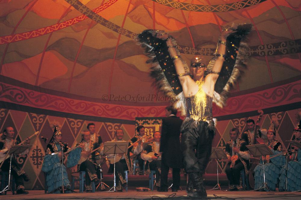 Kazakh performing eagle dance<br /> In honour of Golden eagle hunting<br /> Bayan Ulgii<br /> Western Mongolia