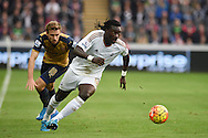 Bafetimbi Gomis of Swansea city breaks away from Nacho Monreal of Arsenal. Barclays Premier league match, Swansea city v Arsenal  at the Liberty Stadium in Swansea, South Wales  on Saturday 31st October 2015.<br /> pic by  Andrew Orchard, Andrew Orchard sports photography.