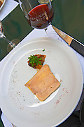 A plate with duck's liver foie grad de canard mi-cuit and a glass of wine - a delicious starter first course Saint Emilion Village Bordeaux Gironde Aquitaine France