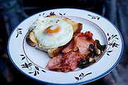Today's menu at the Bainton house: fried eggs with toast, ham, and mushrooms. Hungry Planet: What the World Eats (p. 142). The Bainton family of Collingbourne Ducis, Wiltshire, England, is one of the thirty families featured, with a weeks' worth of food, in the book Hungry Planet: What the World Eats.