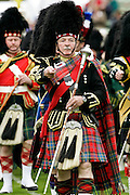 Drum Major leads massed band of Scottish pipers at the Braemar Games Highland Gathering