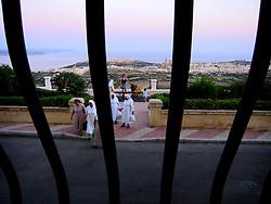 MALTA GOZO NADUR 19JUL06 - Catholic nuns stroll along the promenade at Nadur heights, enjoying the sunset and view over the Gozo Channel and the islands of Comino and Malta...jre/Photo by Jiri Rezac..© Jiri Rezac 2006..Contact: +44 (0) 7050 110 417.Mobile:  +44 (0) 7801 337 683.Office:  +44 (0) 20 8968 9635..Email:   jiri@jirirezac.com.Web:    www.jirirezac.com