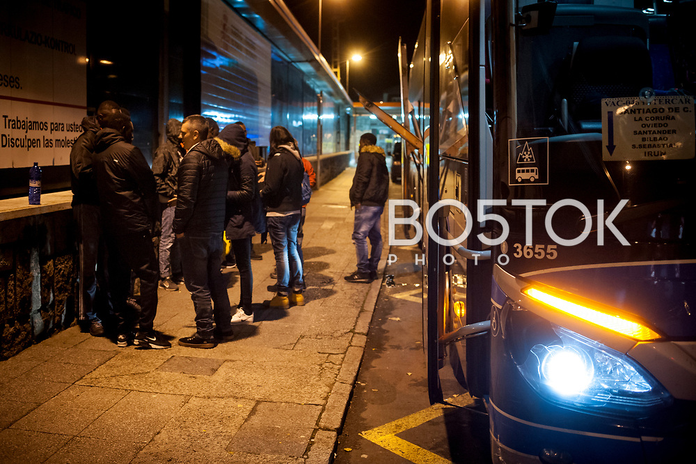 A group of volunteers talks with some African migrants who arrived on the night bus to explain them that they can spend the night in the Red Cross device. Irun (Basque Country). December 19, 2018. A group of volunteers has created a host network to serve migrants and inform about the public services they are entitled to and the ways to cross the border. This group of volunteers is avoiding a serious humanitarian problem Irun, the Basque municipality on the border with Hendaye. As the number of migrants arriving on the coasts of southern Spain incresead, more and more migrants are heading north to the border city of Irun. French authorities have reacted by conducting random checks as far as the city of Bordeaux, more than 200 kilometers north of the border. Migrants who are caught are then deported back to Irun. (Gari Garaialde / Bostok Photo).