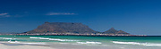 Table Mountain, the natural phenomenon that guards Cape Town to some degree from the prevailing South Easter wind. Table Bay in foreground. Stitched panoramic image by Greg Beadle