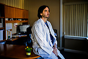 30172555A AUSTIN, Ind. - Saturday March 28, 2015 - Dr. Will Cooke, 43, poses for a portrait in his Austin office. Cooke, came to Austin in 2004 because they didn't have a doctor in town. Scott County in southern Indiana currently has a HIV public health emergency related to intravenous drug use. There are now 79 confirmed cases of HIV in the town of 4,300.<br /> <br /> William DeShazer for the New York Times