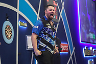 Luke Humphries wins his third round match against Nico Kurz and celebrates during the PDC William Hill World Darts Championship at Alexandra Palace, London, United Kingdom on 23 December 2019.