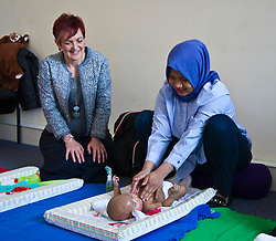 Pictured: Angela Constance, Communities Secretary enjoyed watching the baby massage session with Anggi Wullan and baby Freya (2.5 months)<br /> Today Communities Secretary  Angela Constance visited Dr Bells family centre, where she met staff and volunteers ahead of the first Tackling Child Poverty Delivery Plan being published.<br /> <br /> <br /> Ger Harley | EEm 29 March 2018