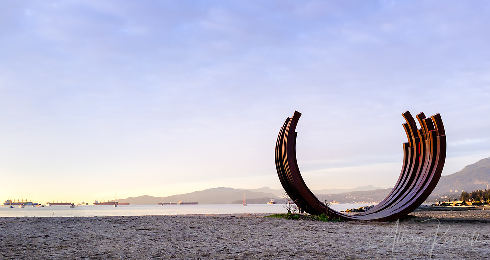 A sculpture overlooking English Bay in Vancouver, British Columbia resembles the shape of a boat or a whale