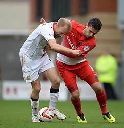 Milton Keynes Dons' Luke Chadwick and Leyton Orient's Mathieu Baudry compete for the ball - Photo mandatory by-line: Mitchell Gunn/JMP - Tel: Mobile: 07966 386802 12/10/2013 - SPORT - FOOTBALL - Brisbane Road - Leyton - Leyton Orient V MK Dons - League One