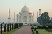 The Taj Mahal on a misty sunrise morning before the crowds arrive