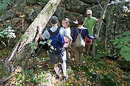 Warwick, New York - Hikers look at the entrance to a cave at Fuller Mountain Preserve as part of the 2012 Hudson River Valley Ramble on Sept. 15, 2012. The preserve is owned and managed by the Orange County Land Trust.