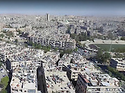 Drone footage shows how Syrian city of Aleppo still appears a modern thriving town in government-held areas and a devastated warzone elsewhere<br /> <br /> Syria may not be top of many people's holiday lists for 2017, but its tourism ministry has released a video advertising a side of war-torn city Aleppo that can scarcely be believed.<br /> <br /> Drone footage shows the citizens in the Government-held half bathed in glorious sunshine they go about their daily business in the surroundings of grand buildings, fabulous gardens and huge swimming pools.<br /> <br /> It is a stark and harrowing comparison to the other half of Aleppo, which is currently being bombed to smithereens by missiles from President Bashar al-Assad as well as from the Russian military.<br /> ©Exclusivepix Media