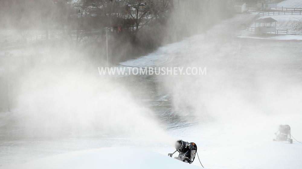 Hamptonburgh, New York - Snow-making machines blow snow onto the snow-tubing hill at Thomas Bull Memorial Park on Dec. 14, 2010.