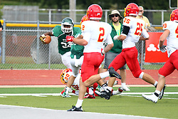 19 September 2015:  Maurice Shoemaker-Gilmore tiptoes up the sideline after hoping over Zach Rathman during an NCAA division 3 football game between the Simpson College Storm and the Illinois Wesleyan Titans in Tucci Stadium on Wilder Field, Bloomington IL