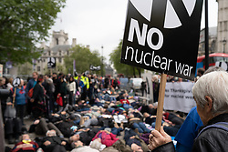 May 3, 2019 - London, Greater London, United Kingdom - Activists seen lying outside Westminster Abbey during the Thanksgiving service for the Navy..Anti-nuclear protests outside of Westminster Abbey whilst a Thanksgiving service for the Navy took place inside the Abbey. (Credit Image: © Lexie Harrison-Cripps/SOPA Images via ZUMA Wire)