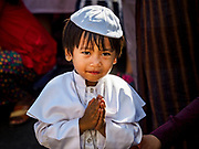30 NOVEMBER 2017 - YANGON, MYANMAR: A boy in a Pope costume pretends to pray during the Papal Mass at St. Mary's Cathedral in Yangon. Thursday's mass was his last public appearance in Myanmar. From Myanmar the Pope went on to neighboring Bangladesh.   PHOTO BY JACK KURTZ