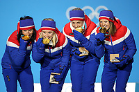 PYEONGCHANG,SOUTH KOREA,18.FEB.18 - OLYMPICS, NORDIC SKIING, CROSS COUNTRY SKIING - Olympic Winter Games PyeongChang 2018, Medals Plaza, 4 x 5km relay, ladies, award ceremony. Image shows Ingvild Flugstad Østberg, Astri Uhrenholdt Jacobsen, Ragnhild Haga and Marit Bjørgen (NOR). Keywords: medals. <br /> <br /> Norway only