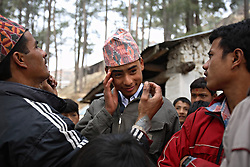 Prakash Balami, 15, is groomed by friends and family for his wedding ceremony in Kagati Village, Kathmandu Valley, Nepal on Jan. 23, 2007.  Early marriage is a harmful traditional practice common in Nepal. The Kagati village, a Newar community, is most well known for its propensity towards this practice. Many Hindu families believe blessings will come upon them if marry off their girls before their first menstruation.
