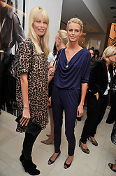 Left to right, Claudia Schiffer and JACQUETTA WHEELER at a reception hosted by Vogue and Burberry to celebrate the launch of Fashions Night Out - held at Burberry, 21-23 Bond Street, London on 10th September 2009.
