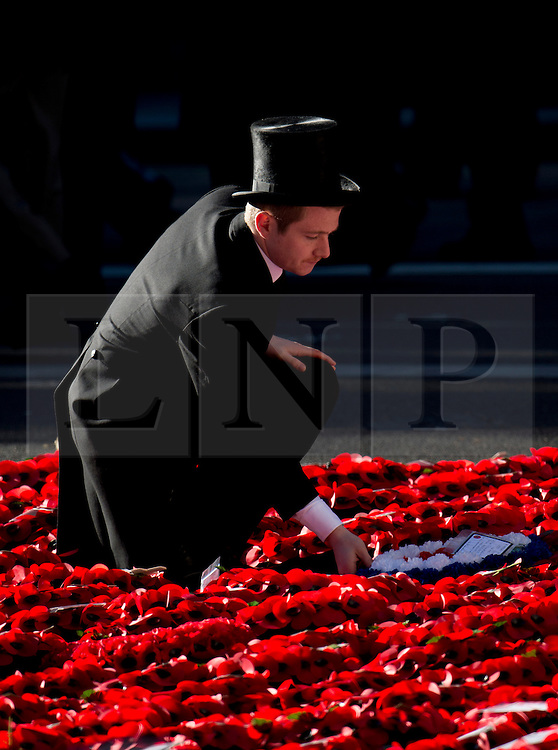 © London News Pictures. 10/11/2013. London, UK. A wreath being placed at the Ceneotaph during a Remembrance Day Ceremony at the Cenotaph war memorial in London, United Kingdom, on November 10, 2013 . Royalty and Politicians joined the rest of the county in honouring the war dead by gathering at the iconic memorial to lay wreaths and observe two minutes silence. Photo Credit: Ben Cawthra/LNP