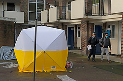 © Licensed to London News Pictures 06/02/2021.        Croydon, UK. A police forensic tent in a court yard area of a block of flats. A man has been killed and ten others have been stabbed with two in a life threatening condition in hospital after a night of knife violence in Croydon, South London. Police have put a large cordon in place at the murder scene in Wisbeach Road. Photo credit:Grant Falvey/LNP