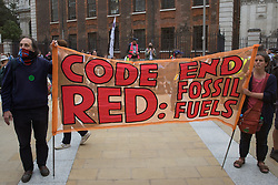 Environmental activists from Extinction Rebellion assemble in Paternoster Square following a Blood Money March through the City of London on 27th August 2021 in London, United Kingdom. Extinction Rebellion were intending to highlight financial institutions funding fossil fuel projects, especially in the Global South, as well as law firms and institutions which facilitate them, whilst calling on the UK government to cease all new fossil fuel investment with immediate effect.