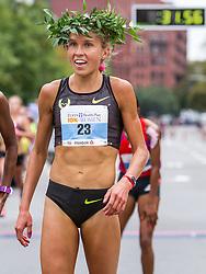 Tufts Health Plan 10K for Women, winner Jordan Hasay wears laurel wreath