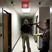Investigators Daniel Fuentes, left, and Mike Lopez compare notes on the stories suspects Gabriel Hernandez and Ana Salinas were telling them during their interrogations at the Hidalgo County Sheriff's office. Lopez handled Hernandez' interrogation as Fuentes questioned Salinas. The two would frequently take breaks in the hallway during several hours long questioning. <br /> Nathan Lambrecht/The Monitor