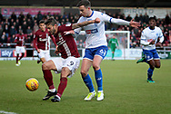 Northampton Town striker Marc Richards (9) shields the ball from Bury Town defender Bury Town defender Eoghan O'Connell (6) the EFL Sky Bet League 1 match between Northampton Town and Bury at Sixfields Stadium, Northampton, England on 25 November 2017. Photo by Nigel Cole.