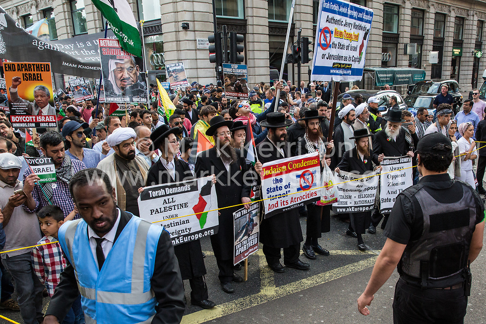 London, UK. 10th June, 2018. Orthodox Haredi Jews from Neturei Karta join hundreds of people taking part in the pro-Palestinian Al Quds Day march through central London organised by the Islamic Human Rights Commission. An international event, it began in Iran in 1979. Quds is the Arabic name for Jerusalem.