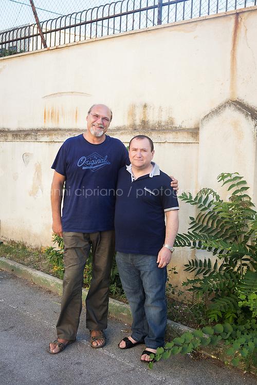 PALERMO, 29 LUGLIO 2015: (Sinistra-destra) Padre Antonio Guglielmi e Padre Danilo Volonté, parroci della Parrocchia di Santa Lucia Borgovecchio, sono qui nel cortile della chiesa a Palermo il 29 luglio 2015.